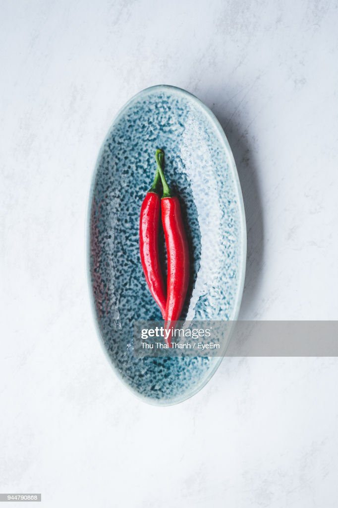 Directly Above Shot Of Red Chili Peppers In Bowl On Table : Stock Photo
