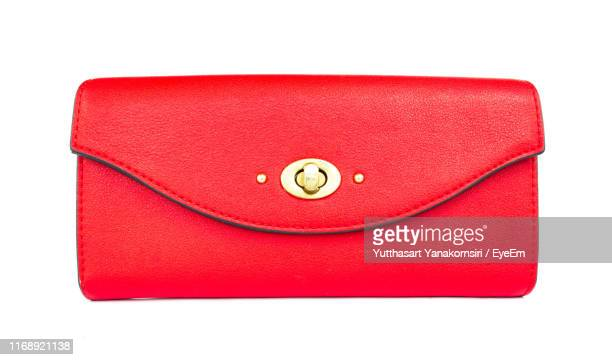 directly above shot of red clutch on white background - pochette borsetta foto e immagini stock