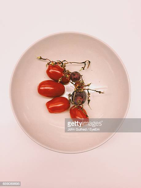 Directly Above Shot Of Red Fruits In Plate