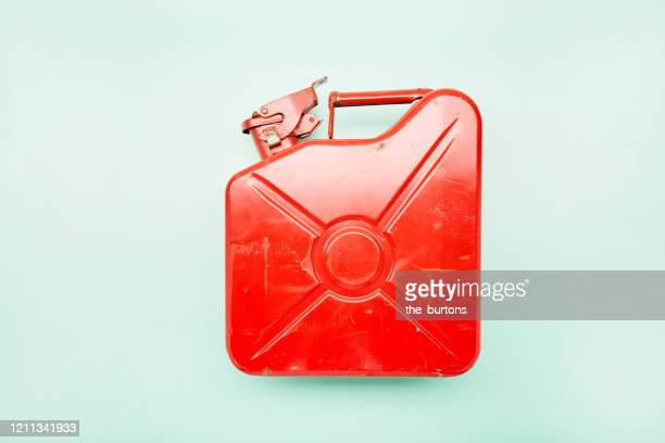 directly above shot of red oil canister on turquoise background - キャニスター ストックフォトと画像