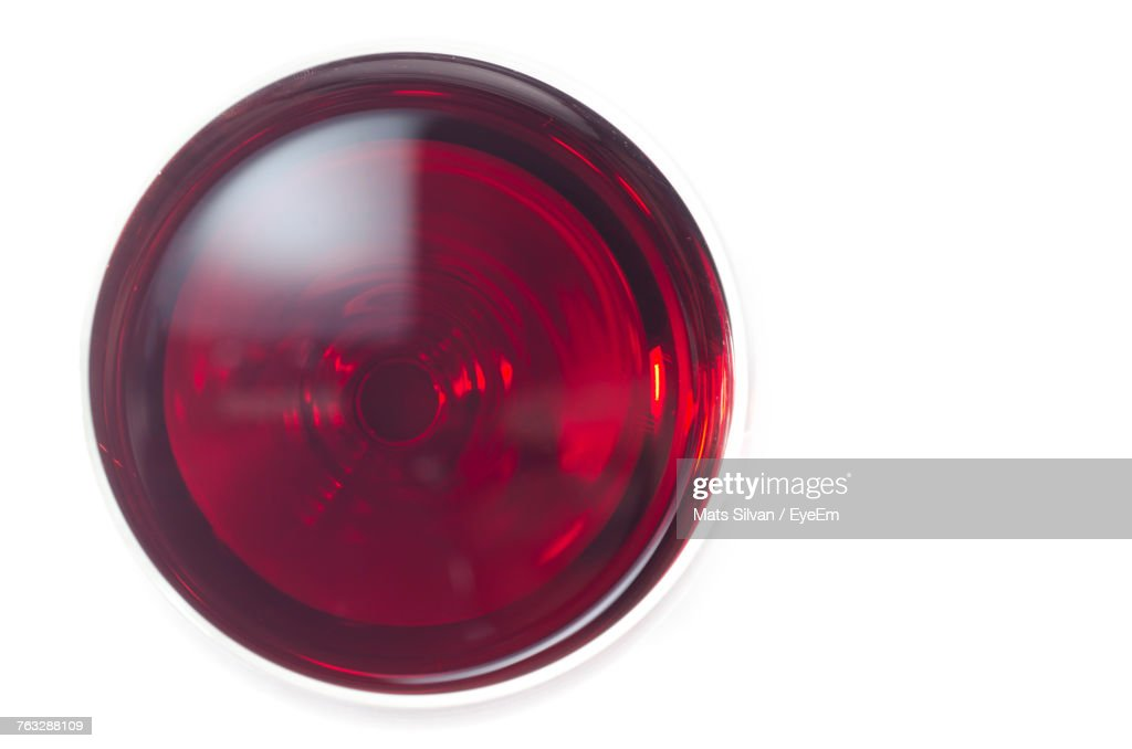 Directly Above Shot Of Red Wine Over White Background : Stock Photo