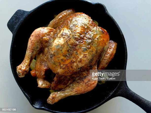directly above shot of roasted chicken in pan - roast chicken stock pictures, royalty-free photos & images