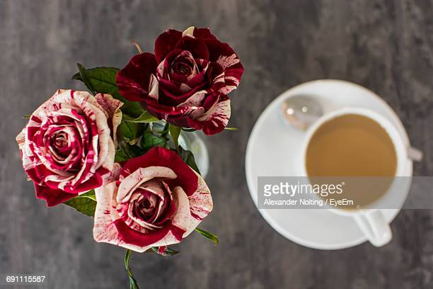 Directly Above Shot Of Roses And Coffee