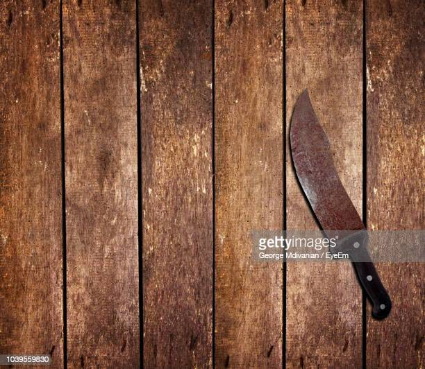 directly above shot of rusty knife on hardwood floor - george wood stock pictures, royalty-free photos & images