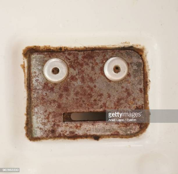 Directly Above Shot Of Rusty Metal With Anthropomorphic Face