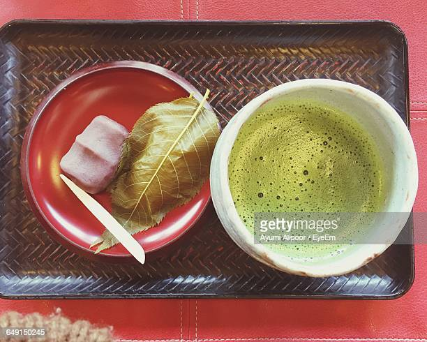 Directly Above Shot Of Sakuramochi And Drink In Tray