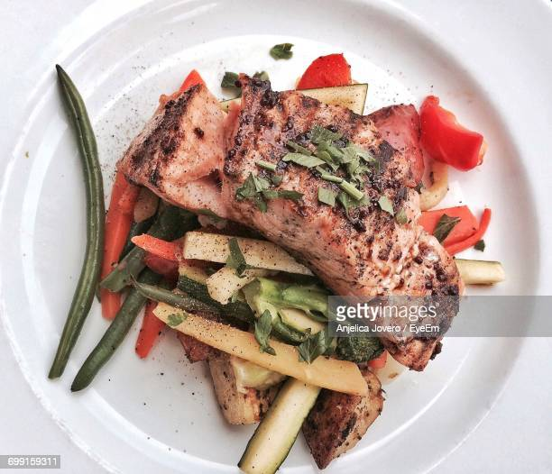 directly above shot of salmon served in plate - bush bean stock photos and pictures
