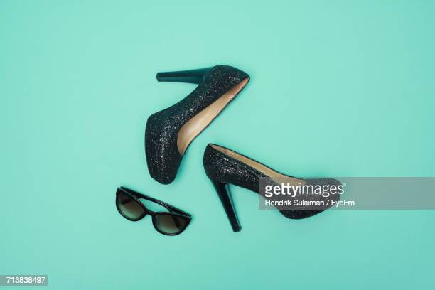 directly above shot of sandals and sunglasses on turquoise background - high heels stock pictures, royalty-free photos & images