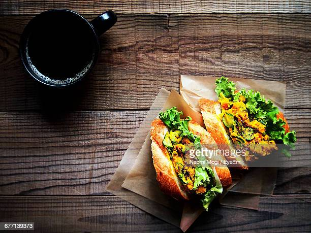 Directly Above Shot Of Sandwiches With Black Coffee Served On Table