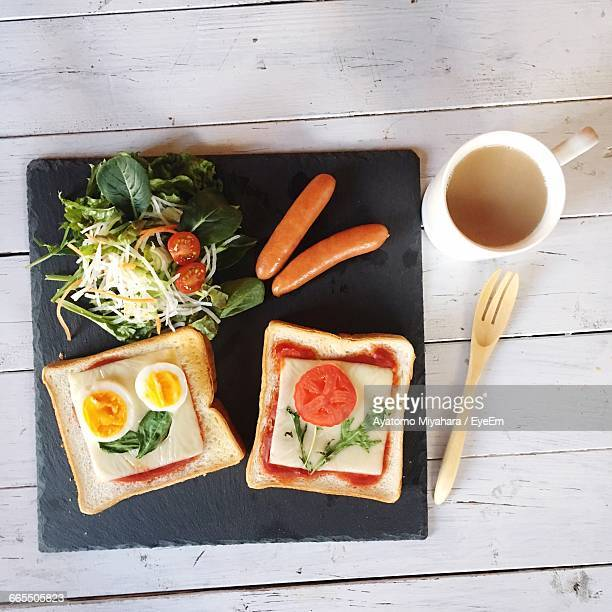 Directly Above Shot Of Sandwiches With Coffee On Table At Home