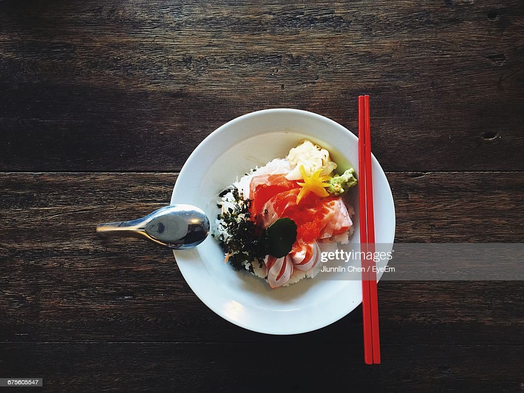 Directly Above Shot Of Sashimi Served In Bowl On Wooden Table : Stock-Foto
