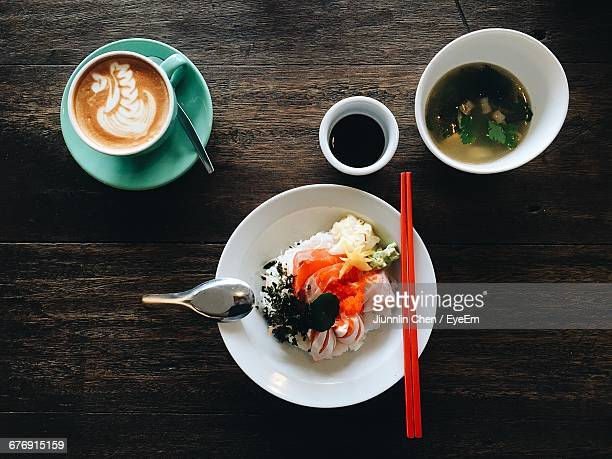 directly above shot of sashimi with miso soup and coffee on wooden table - washoku fotografías e imágenes de stock