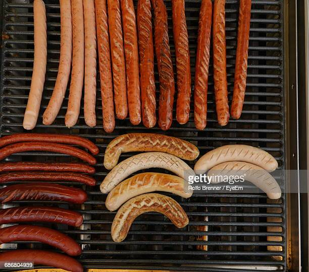 Directly Above Shot Of Sausages On Barbecue