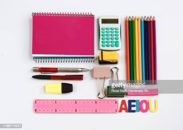 directly above shot of school supplies on white background. - school supplies stock pictures, royalty-free photos & images