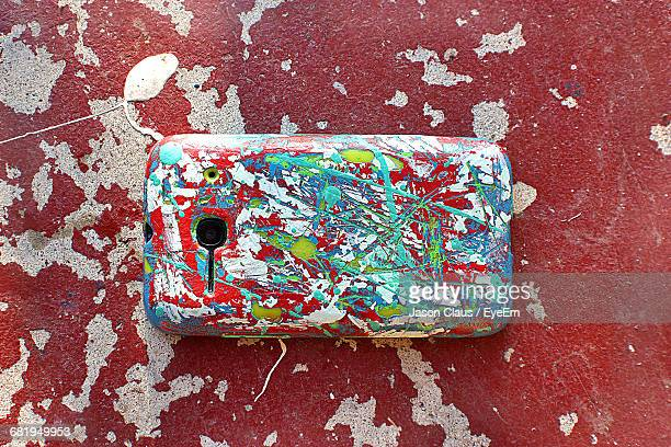 directly above shot of scratched mobile phone on wall - phone cover stock pictures, royalty-free photos & images