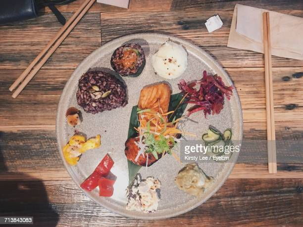 Directly Above Shot Of Seafood In Plate On Wooden Table At Restaurant