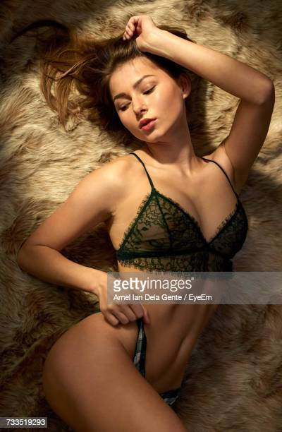 Directly Above Shot Of Sensuous Woman Lying On Bed
