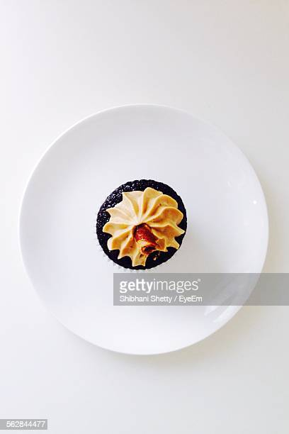Directly Above Shot Of Served Chocolate Cupcake In Plate