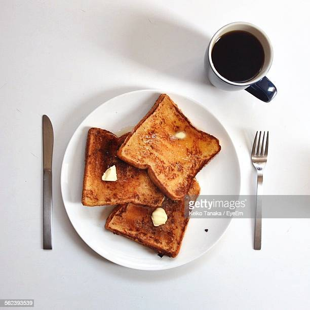 Directly Above Shot Of Served Toasted Bread With Black Coffee On Table