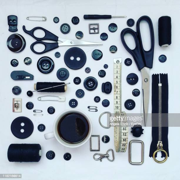 directly above shot of sewing item arranged on gray background - knolling concept stock pictures, royalty-free photos & images
