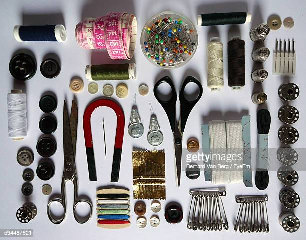 Directly Above Shot Of Sewing Kit Arranged On Table