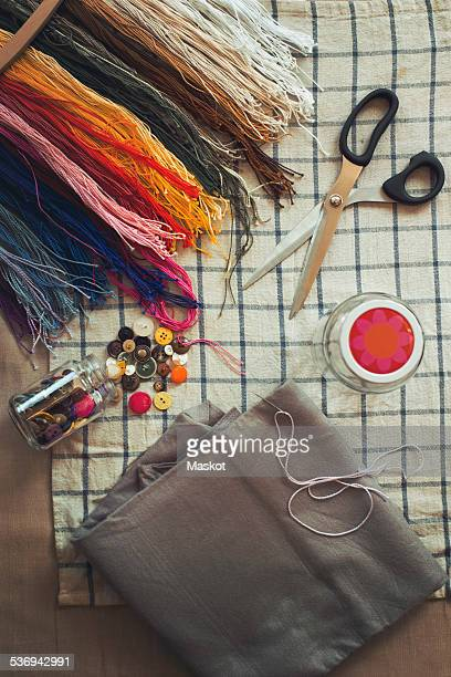 Directly above shot of sewing tools on table