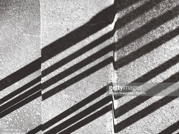 Directly Above Shot Of Shadow On Steps During Sunny Day