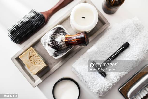 directly above shot of shaving equipment over white background - shaving brush stock photos and pictures