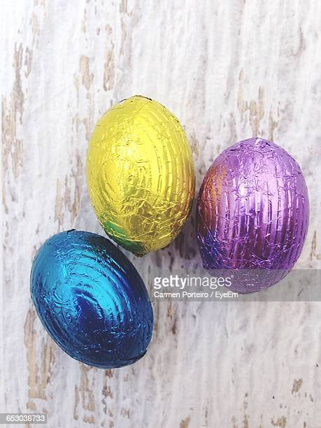 Directly Above Shot Of Shiny Easter Eggs On Table