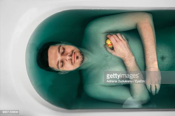 Directly Above Shot Of Shirtless Man In Bathtub