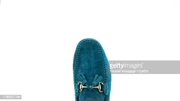 directly above shot of shoe over white background - loafers stock pictures, royalty-free photos & images
