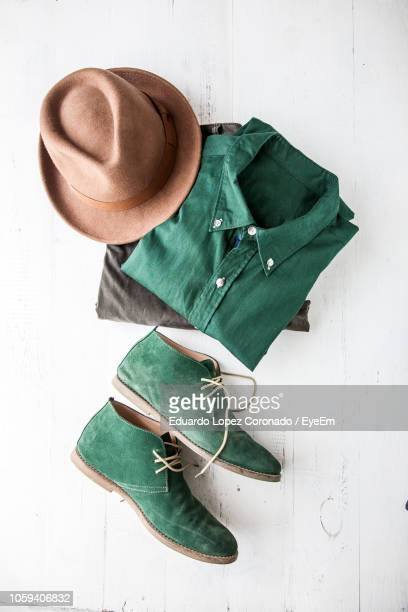 Directly Above Shot Of Shoes And Clothing On Table