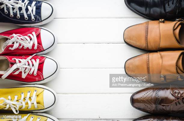 directly above shot of shoes on table - pump dress shoe stock pictures, royalty-free photos & images