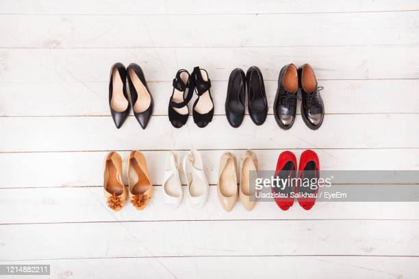 directly above shot of shoes over wooden floor - womenswear stock pictures, royalty-free photos & images