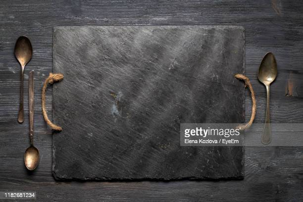 directly above shot of slate with spoons on table - serving tray stock pictures, royalty-free photos & images