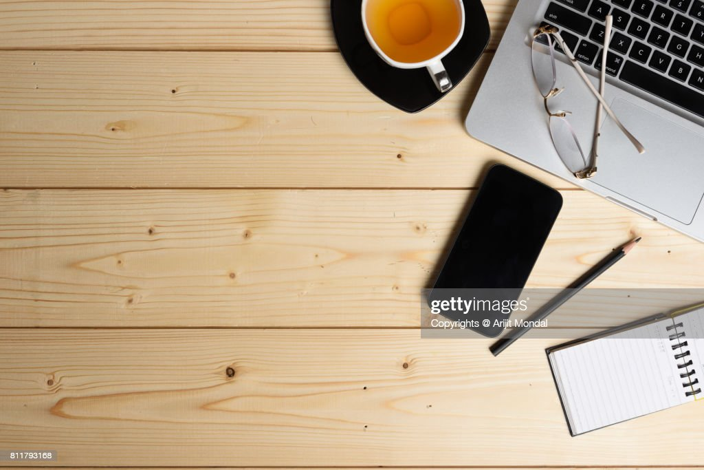 Directly Above Shot Of Smart Phone, Green Tea Cup, Laptop and Office Supplies : Stock Photo