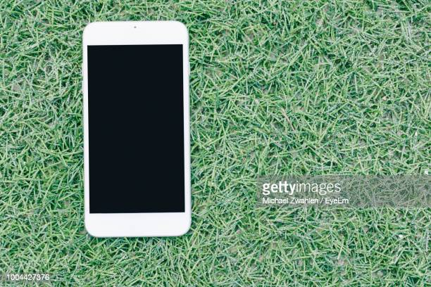 Directly Above Shot Of Smart Phone On Turf