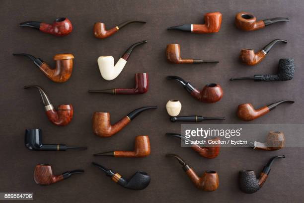 directly above shot of smoking pipes on table - collection photos et images de collection