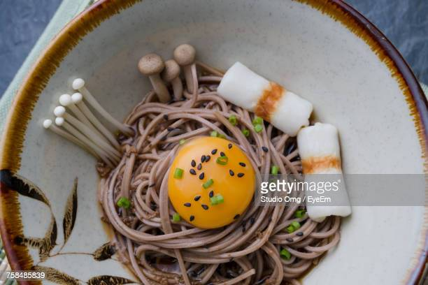 Directly Above Shot Of Soba Noodles With Chikuwas And Egg Yolk Served On Table