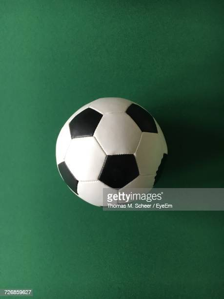 Directly Above Shot Of Soccer Ball On Green Background