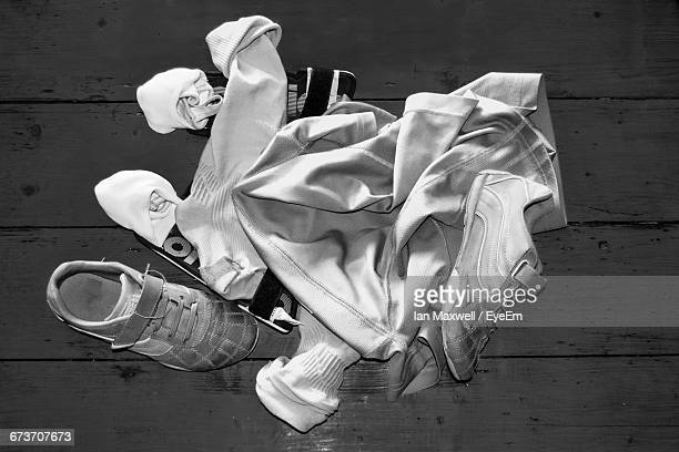directly above shot of soccer uniform and shoes on table - sports uniform ストックフォトと画像
