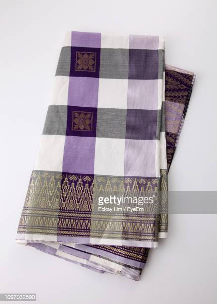 directly above shot of songket sari on white background - sari stock pictures, royalty-free photos & images
