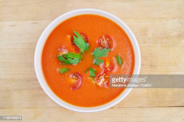 directly above shot of soup in bowl on table - soup stock pictures, royalty-free photos & images