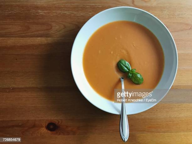 Directly Above Shot Of Soup Served On Wooden Table