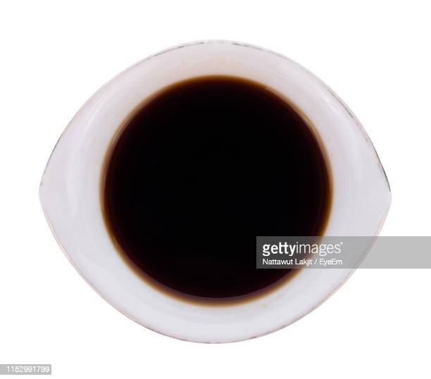 directly above shot of soy sauce on white background - soy sauce stock pictures, royalty-free photos & images