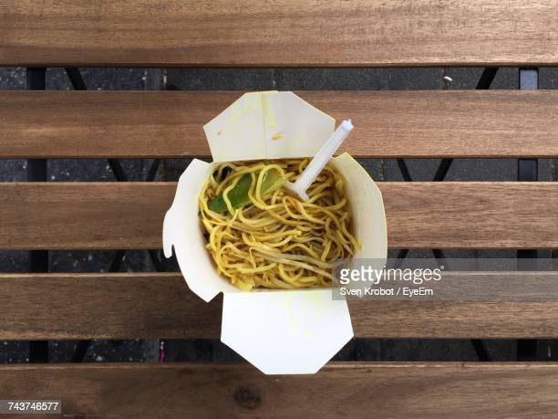 Directly Above Shot Of Spaghetti In Box On Wooden Bench