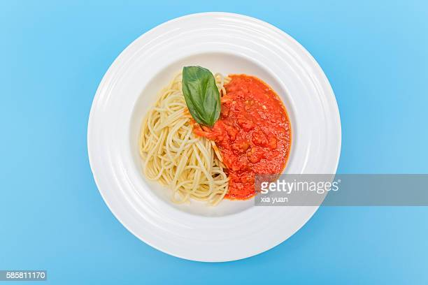 Directly above shot of spaghetti with Meat Tomato Sauce on a White Plate