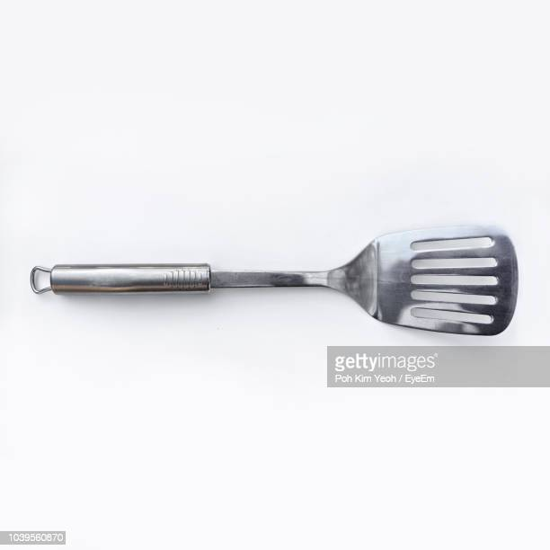 directly above shot of spatula on white background - cooking utensil stock photos and pictures