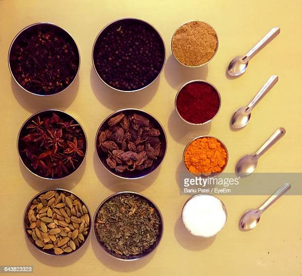 Directly Above Shot Of Spices In Bowl With Spoons On Table