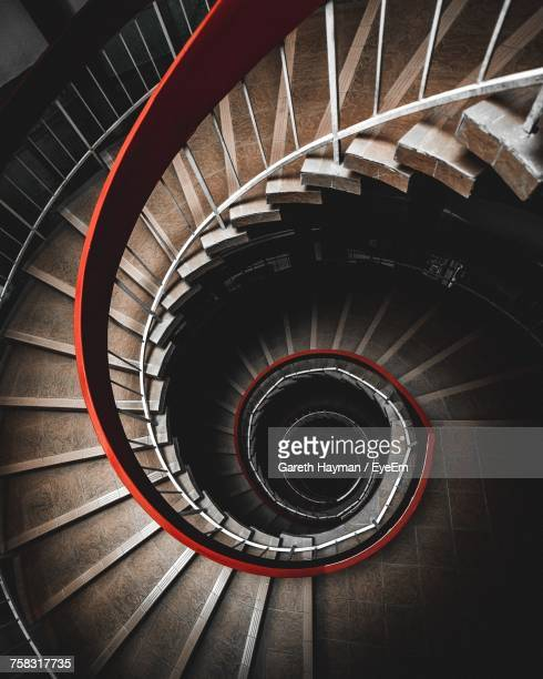 directly above shot of spiral staircase in building - spiral stock pictures, royalty-free photos & images